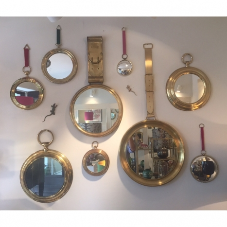 collection of mirrors, mid century brass
